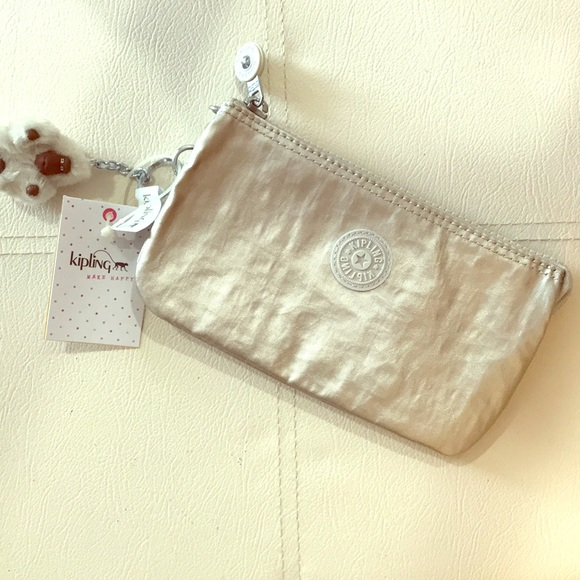 various kinds of better price for classic style Kipling Nylon Expandable Clutch NWT